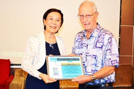 Toy from Pattaya Orphanage is presented a Certificate of Appreciation on behalf of the Pattaya City Expats Club by Board Member and former Chairman Richard Smith for her excellent presentation on the Pattaya Orphanage and the Human Help Network Foundation.