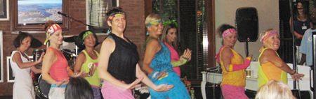 Stephanie Moorehouse leads PILC members in an energetic demonstration of Zumba.