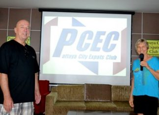 PCEC chair Pat Koester and logo selection committee chair Roy Albiston unveil the PCEC's new logo to the members. (Photo by Urasin Khantaraphan)
