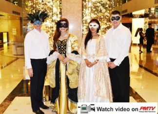 """Dominique Ronge (left), General Manager of Centara Grand Phratamnak Resort Pattaya, and Carl Duggan (right), Executive Assistant Manager - Food and Beverage Centara Grand Pratamnak Resort Pattaya, along with 2 members of their staff dress up for the theme of the """"Carnevale Di Venezia""""."""