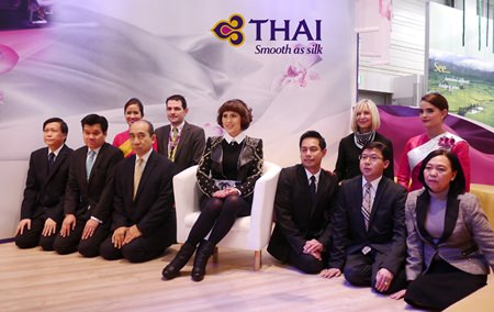 Seated (center): Her Royal Highness Princess Ubolratana Mahidol. Front Row (from right): Soodrak Chanyavongs, Manager of the Promotions Department; Thera Buasri, Airport Service Manager, Frankfurt Airport; Warote Intasara, General Manager, Munich - (from left): Srikit Kattiyakulvanich, Accounting Manager, Germany; Veerayot Purananda, Airport Services Manager, Munich Airport; Pricha Nawongs, Area General Manager, Scandinavia, Finland, Iceland and the Baltic Countries. Second row (from right): Air Hostess; Jutta Yelden, Manager Sales Services, Frankfurt (from left): Air Hostess; Matthias Horn, District Sales Manager, Germany, Austria & Eastern Europe.