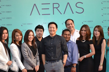 The Urban Property Managing Director Sompop Vanichsenee (center) poses with management colleagues and sales staff at the Aeras Condominium agents' party held March 28.