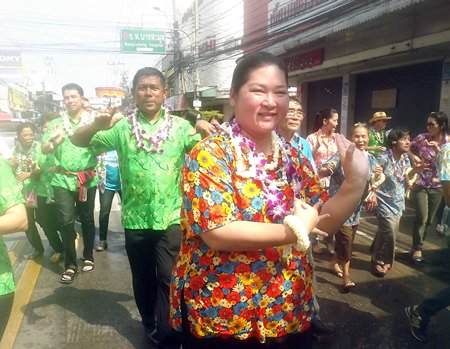 Former Culture Chairperson Sukumol Kunplome dances in the parade.