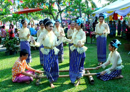 'Lao Kratop Mai' or the bamboo tapping dance being performed by students from Pattaya School No. 9.