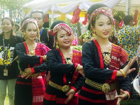 Dancers perform in traditional Thai dress.
