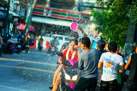 Youths sure have fun throwing water on each other.