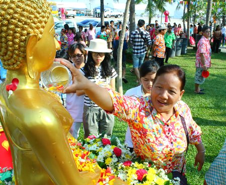 Pattaya citizens pour water on a Lord Buddha image during Naklua's Wan Lai.