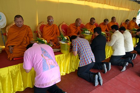 Government officials receive blessings from the Buddhist monks.