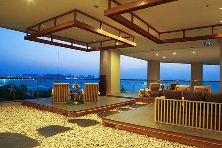 Outdoor massage area overlooking Pattaya Bay.