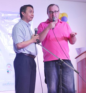 Fr. Peter Pattarapong with Alexander from 'Our World Cultural & Educational Center'.