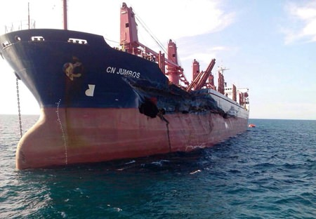 The 165.5-meter CN Jumbos (Above) lists five degrees to starboard as water penetrates three cargo compartments after it collided with the Anton Topic (Below).  No injuries were reported and no oil was spilled, but both vessels were damaged and taken out of service for repairs.