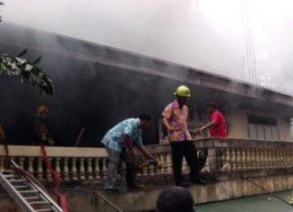 Firefighters work to extinguish a blaze in the abbot's residence at Nongprue Temple.