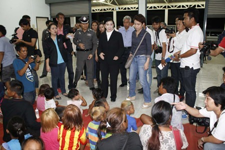 Paveena Hongsakula (center) led her team to rescue 23 children from suspected human traffickers during a raid of four locations in Pattaya.