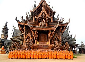 Over a hundred monks prepare to lead a parade throughout the greater Naklua, Pattaya and Jomtien areas so that people could sprinkle holy water on Buddhist relics from the Sanctuary of Truth. The relics were put on a special float (back, left) to give residents and tourists an opportunity to pour holy water on the relics on Songkran Day.