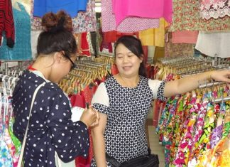 Mayjira Kongkeaw, owner of the Norm Boutique shop, said sales have dropped this year so she cut her prices to 180 baht.