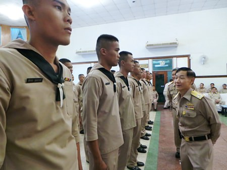 Vice Adm. Wattanachai Piyaphat inspects the troops before sending them off to receive vocational training.