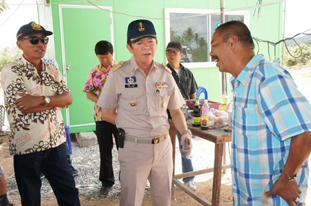 Banglamung District Chief Sakchai Taengho (center) questions Nong Plalai Sub-district Council President Banjet Thimthong (right) about what is thought to be illegal excavation of public land.