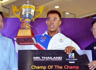 Wuthichai Sangtula from the Muscletech Thailand team holds aloft the prestigious HRH Princess Sirindhorn royal cup after retaining his 'Mr. Thailand' title in Pattaya.