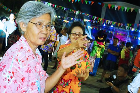 People have fun dancing during the Rice Festival.