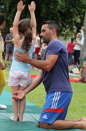 Mr Ivan assists his gymnasts.