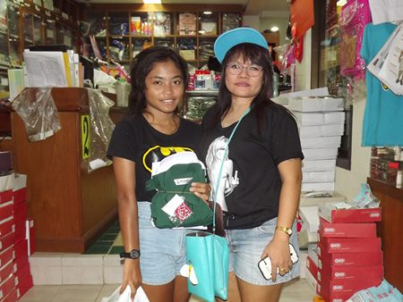 Mae takes daughter Pui to buy her school and Girl Scout uniforms.