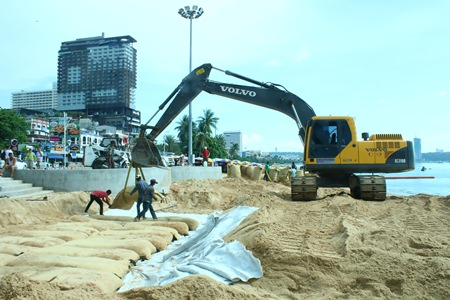 City-owned backhoes install large sandbags - each one 15 meters long, 4 meters wide and a meter thick - at the entrance to Pattaya Beach at the intersection of Beach and Central Roads. The 3.1 million baht project is another attempt by city officials to prevent beach erosion during the rainy season.