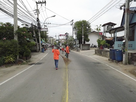 Workers prepare the road to have its dividing lines repainted.