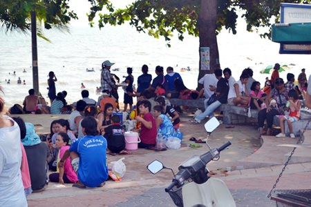 ASEAN citizens relax on National Labor Day at Jomtien Beach.