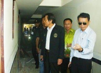 (L to R) Deputy Mayor Ronakit Ekasingh, PBTA President Sinchai Wattanasartsathorn, and Banglamung District Chief Sakchai Taengho inspect the illegal top floors at the Boutique Hotel on Soi VC.