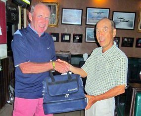 James Ferris (left) receives the MBMG Golfer of the Month award from Mashi Kaneta.