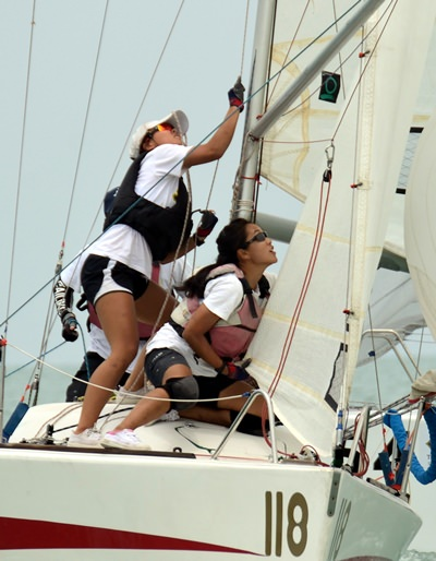 The Singaporean crew on 'Nahm Prix' fight to raise the spinnaker.