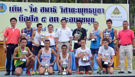 Leading runners in the men's under-40 event pose with their trophies.