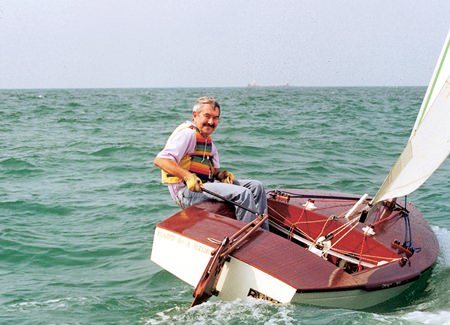 An old sea dog takes his OK dinghy for a spin around the bay.