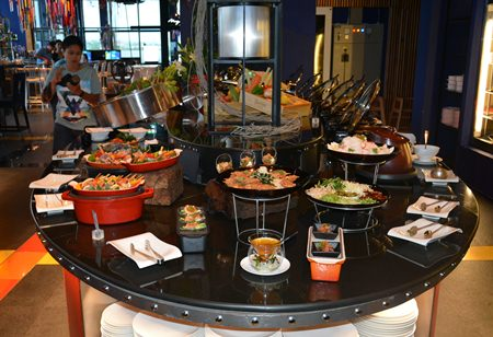 The buffet station offers a variety of seafood and Thai dishes.