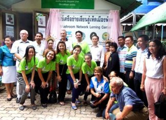 Mayor Itthiphol Kunplome and guests open the mushroom farm.