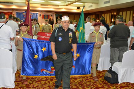 Convention Chairman Al Serrato leads the marching Boy Scouts through the crowd of veterans before the opening ceremony.