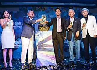 Directors and management of Siam@Siam Hotels join public officials on stage for the grand opening of the new, stylish Siam@Siam Design Hotel Pattaya at a lavish party held May 24. (Standing left-right) Prathanporn Pornprapha, Assistant Managing Director of Siam@Siam Design Hotel Pattaya; Pornpinit Pornprapha, Managing Director of Siam@Siam Hotels; Itthiphol Kunplome, Mayor of Pattaya City; Dr. Pornthep Pornprapha and former senator Sutham Phanthusak, MD of Woodlands Resort Group.