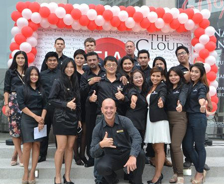 The Cloud sales team and management welcome prospective customers to the project's newly opened showroom.