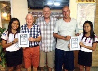 Winners of the two KPK vouchers for May, Gerry Cooney and Thomas Nyborg with Buff and two helpers.