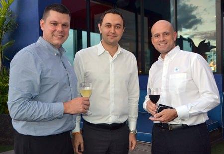 Dmitry Chernyshev (center) welcomes Centara Grand Phratamnak's EAM-F&B Carl Duggan (left) and GM Dominique Rongé (right).