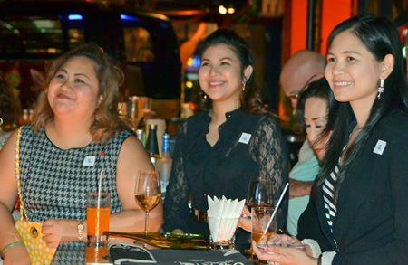 Three guests smiling and enjoying the humorous speech given by Peter Malhotra (L to R) Pichchaya Nitikarn from Amari Pattaya, Nisa Pragopchai from Dusit Thani Pattaya and Janya Rattanaliam, Bangkok Hospital Pattaya.