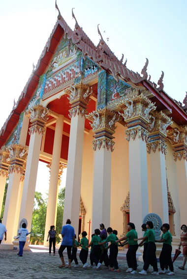 Parading three times around the temple.