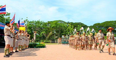 Mayor Itthiphol Kunplome and 116 scouting leaders salute as the Boy & Girls Scours march past.