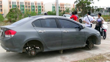 Thieves in the night made off with all 4 wheels, leaving the car on blocks.