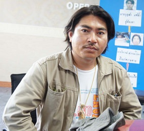 Boonsong Saechau turned himself in to police to face charges of gunning down his cousin in a fit of jealousy.