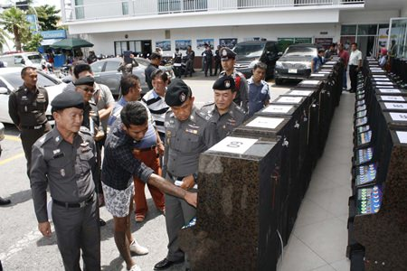 Chonburi provincial police seized 60 slot machines and arrested eight in a raid of a warehouse in Pattaya.