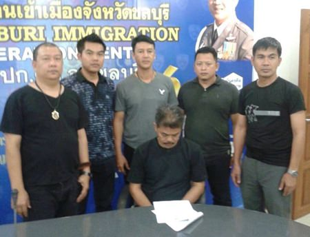 Anucha Sroianusorn (seated) has been arrested and charged with human trafficking.