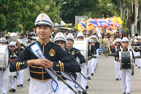 The marching band from Sattahip School leads the procession around Sattahip.