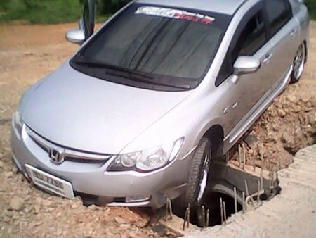 The obstacle course has caused a string of accidents, most recently by Teeranan Opas, who drove his Honda Civic into an unmarked hole, causing damage to the undercarriage.