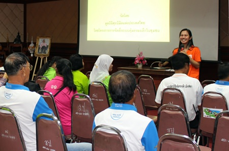 World Vision Foundation of Thailand representative Chalika Haninnee (back right) talks to community leaders about protecting their children.